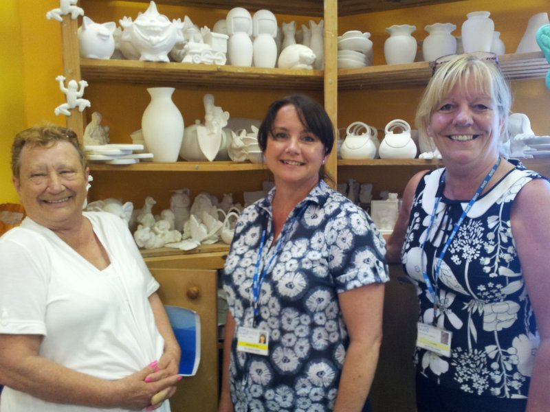 Volunteer advocate Patricia Mills with Unit staff in the crafts area