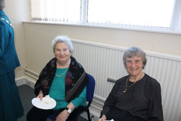 Sheila Murray one of the founders of SPAC (left)with Betty Maddison (right) a long standing volunteer help celebrate the milestone