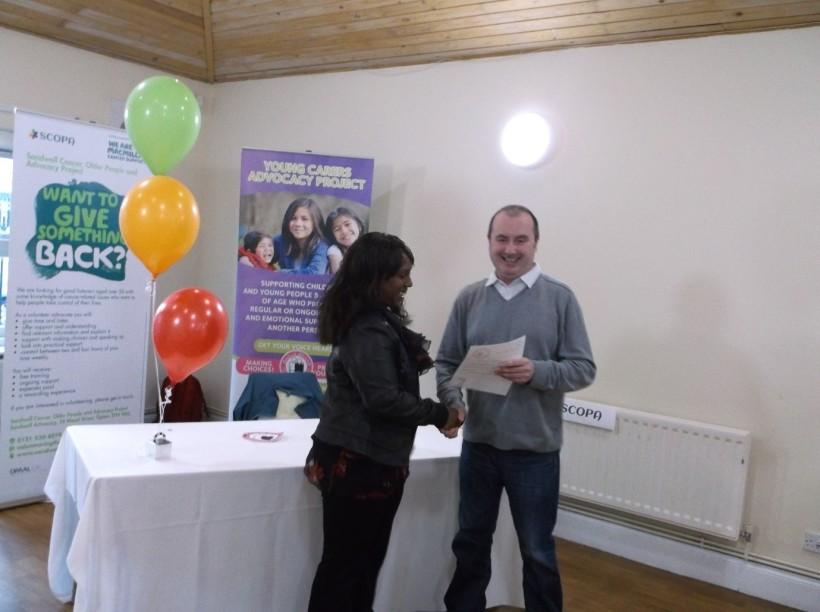 Dave presenting certificate to volunteer Carmen